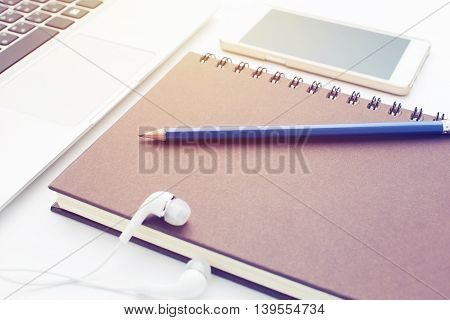 Agenda & Laptop Take notes on white background