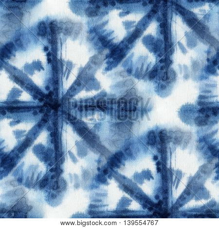 Seamless tie-dye pattern with circles of indigo color on white silk. Hand painting fabrics - nodular batik. Shibori dyeing.