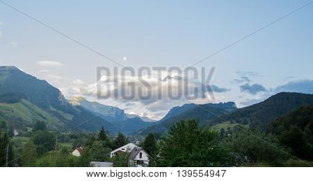 Mountains with clouds above at beautiful colorful summer day