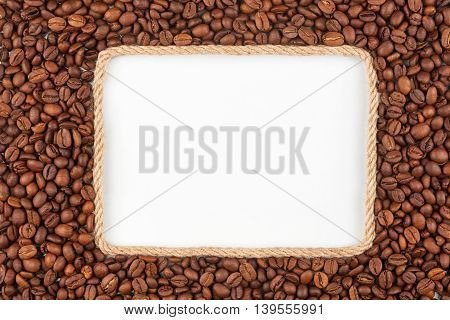 Frame made of rope with coffee beans and a white background with space for your text