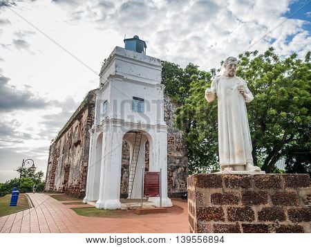 St. Paul's Church with a statue of St. Francis Xavier in Malacca Malaysia