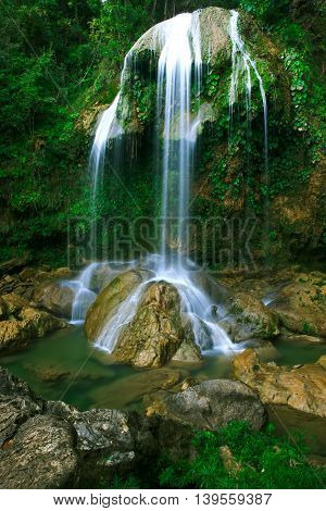 Waterfall in a lush rainforest. Vegas grande waterfall in Topes de Collante, Trinidad, Cuba