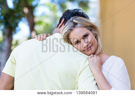 Portrait of happy woman embracing boyfriend