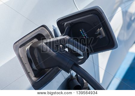 Color image of a plug used to charge an electric car.