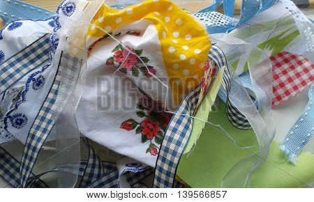 Tattered scraps of mismatched fabric, ribbon and lace