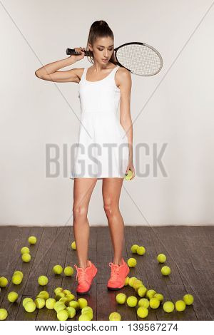 beautiful sporty sexy woman tennis player with racket ready to hit a tennis ball