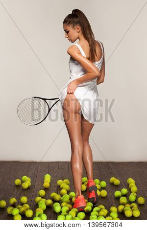 beautiful fitness sexy woman tennis player with racket