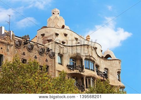 BARCELONA SPAIN - OCTOBER 08 2013: Casa Mila or La Pedrera in Barcelona, Spain. This famous building was designed by Antoni Gaudi