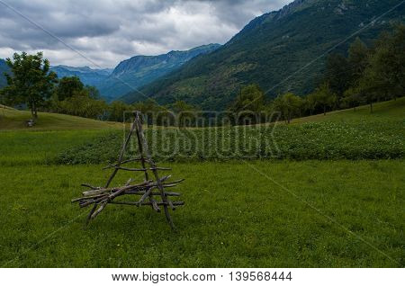 Object on beautiful green field with mountains in back