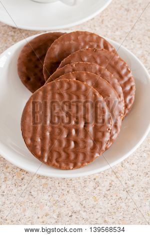 Milk chocolate covered digestive sweetmeal or wholemeal biscuits