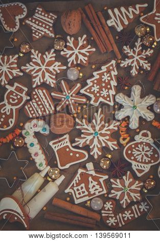 christmas gingerbread cookies background with spices and decorations, retro toned