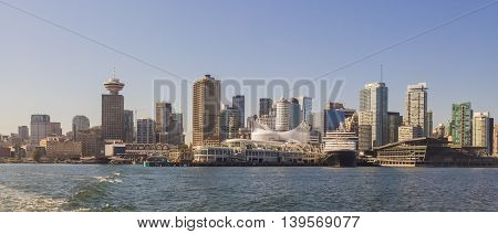 Downtown Vancouver taken from Burrard Inlet, witht he ferry terminal and financial district