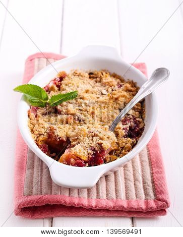 Fruit and berry crumble cake with oat and wholemeal topping