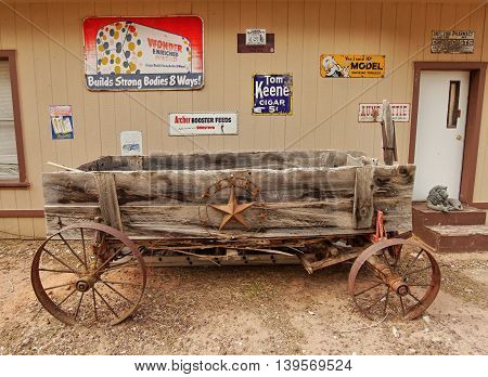 Wooden wagon and symbols Texas. Wild West museum at Holy in The Rock, Utah, USA May 15, 2016