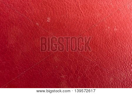 Nice warm red synthetic leather background texture