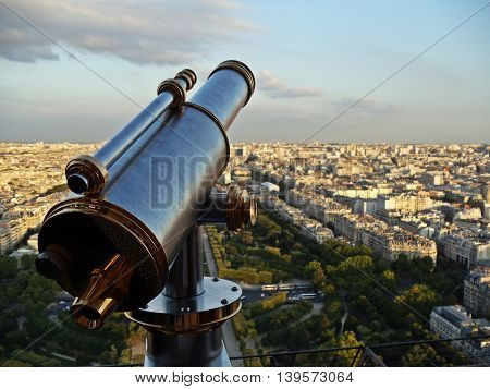 Telescope at the Eiffel tower observation deck in Paris, France