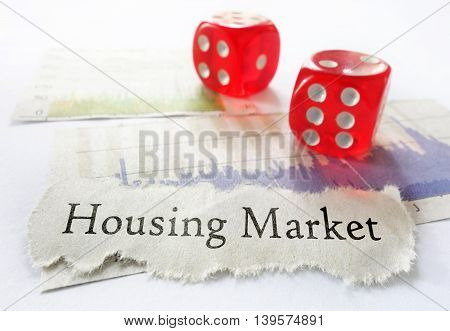 Housing Market newspaper headline with dice and graphs