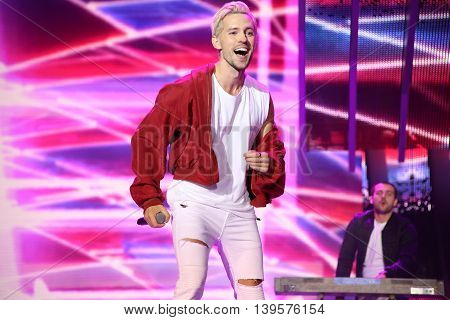 VITEBSK, BELARUS - JULY 17: Latvian pop singer Markus Riva performs during the 25th Slavyansky Bazar Festival on July 17, 2016 in Vitebsk, Belarus