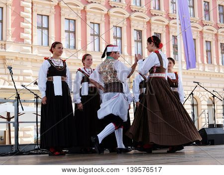 ZAGREB, CROATIA - JULY 23: Members of folk group Kumpanija from Blato, island of Korcula, Croatia  during the 50th International Folklore Festival in center of Zagreb, Croatia on July 23, 2016