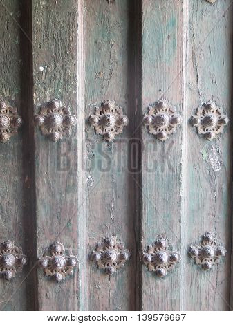Wooden Church door with studs in Jaen