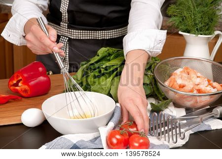 Woman cooking Healthy Food - Vegetable Salad. Dieting Concept. Healthy Lifestyle. Cooking At Home. Prepare Food