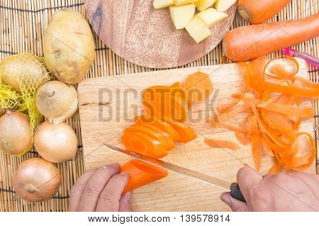 Chef is cutting carrots / cooking Japanese pork curry paste concept /Top view