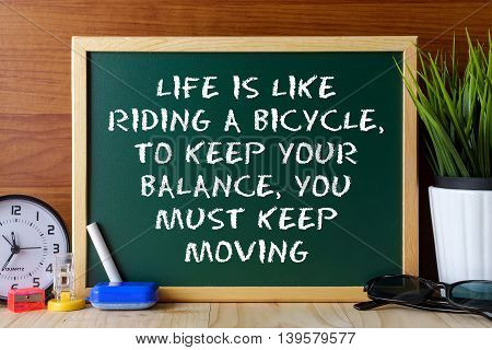 Word Quote Life Is Like Riding A Bicycle,to Keep Your Balance,you Must Keep Moving Written On Green