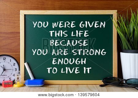 Word Quote You Were Given This Life Because You Are Strong Enough To Live It Written On Green Chalk