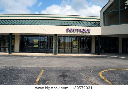 SHOREWOOD, ILLINOIS / UNITED STATES - AUGUST 30, 2015: Vacant space for a boutique is available for lease in a Shorewood strip mall.