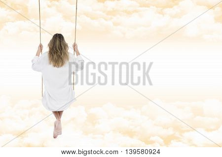 Woman With White Shirt On The Swing Through The Clouds Of An Amber Sky
