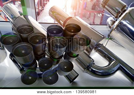 Exhaust pipe , Pipe during production and exhaust pipe for motor sports  at  car shop .