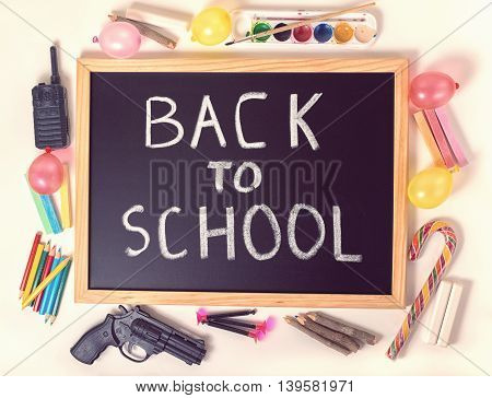 Top Down Concept Of Education With Text Back To School Is Written In Chalkboard, Chalks, Toys And Co