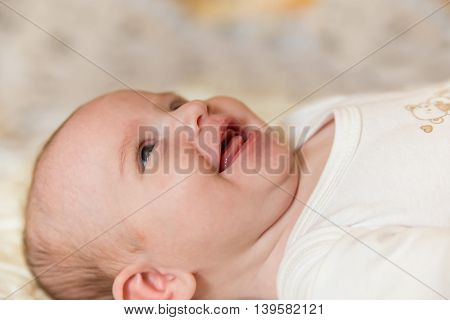Cute smiling newborn baby 3 months old