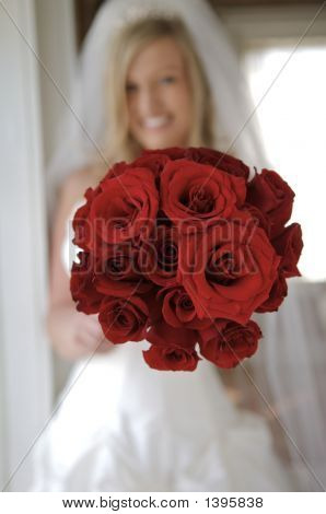 Smiling Bride With Red Rose Bouquet