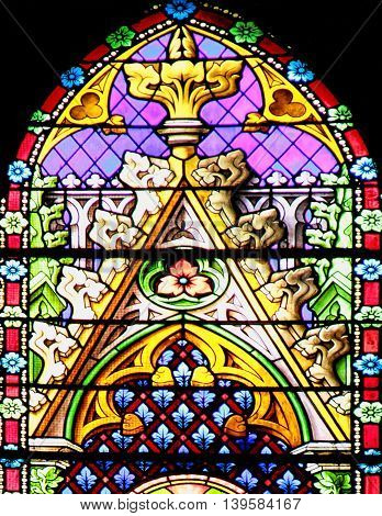 MEZE, FRANCE -July 23, 2014: Colourful seamless stained glass window panel in the Cathedral of Meze South of France