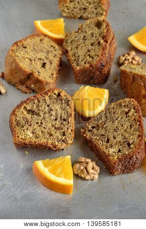 The orange cake with walnuts, vertical, selective focus