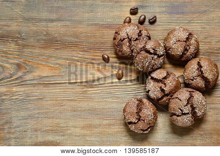 Chocolate cookies with cracks on wooden background, top view