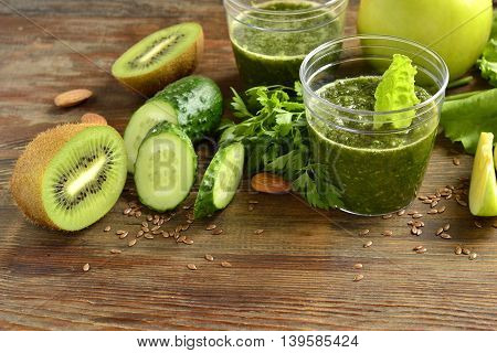 Healthy green smoothies with ingredients. Detox vegetarian diet concept.
