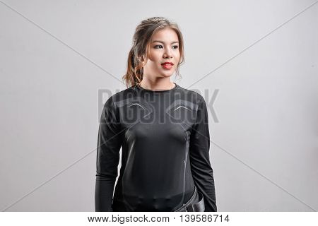 Young Beautiful Black Sport Wear Girl With Style On White Background. Model Posing.
