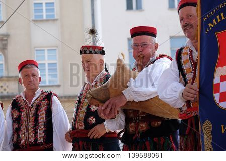 ZAGREB, CROATIA - JULY 23: Members of folk group from Vrlika, Croatia  during the 50th International Folklore Festival in center of Zagreb, Croatia on July 23, 2016