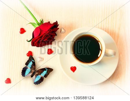 cup of coffee red hearts butterfly and roses for Valentine's Day