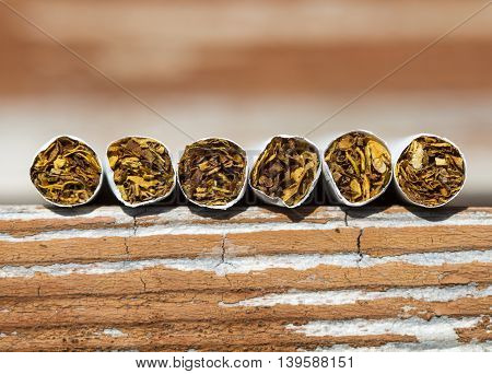 Close-up of Tobacco Cigarettes on wood surface. Background or texture