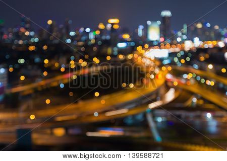 Abstract blurred light highway interchanged with city background