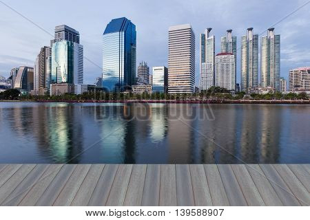 Opening wooden floor, Reflection of Office building night view