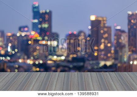 Opening wooden floor, Blurred bokeh business district lights at night