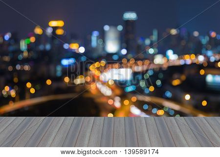 Opening wooden floor, City blurred bokeh lights at night