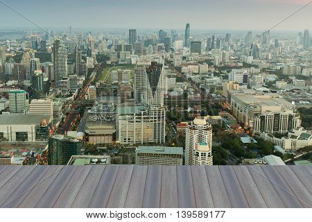 Opening wooden floor, Aerial view office building city downtown, Bangkok Thailand