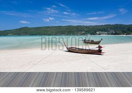 Opening wooden floor, Long tail Fishing boat on the beach, natural landscape background