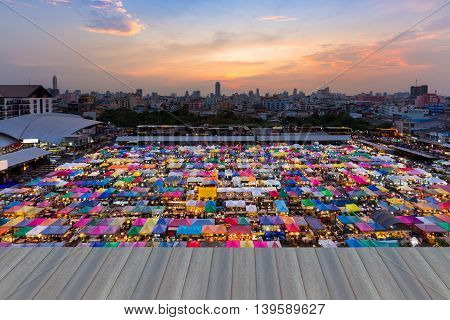 Opening wooden floor, Aerial view of flea market with beautiful sky after sunset