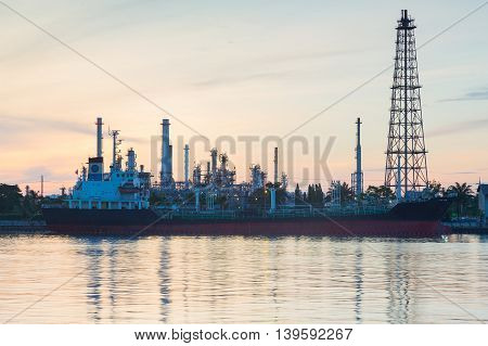 Oil refinery and boat tank on the river during sunrise, Bangkok Thailand
